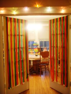 Cinco De Mayo Decorations!-make streamers for the background of cashier's table-use black tablecloths & bright ribbons !