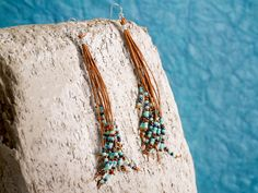Great way to use up odd seed beads and thin cord. http://www.artbeads.com/leather-tassel-earrings-shasta.html?email=YmVhZGluZ2dlbUB5YWhvby5jYQ..