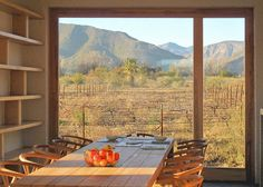 Dining Room with a view of a vineyard and the Swartberg mountains in South Africa. The Architect Is In: A Passive Solar House for a Family of Stargazers - Remodelista African House, Passive Solar Homes, Desert Homes, Solar House, Decoration Inspiration, Architect Design, Large Windows, Beautiful Buildings, Planer