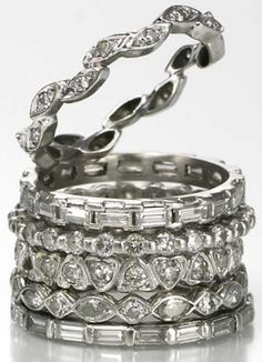 Beth Bernstein's stack of diamond and platinum eternity bands. Several are antique, but she had the topmost made from diamonds that were originally in a pendant that her father gave to her mother. Via Diamonds in the Library.