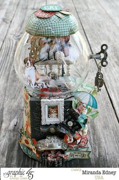 Check out this incredible altered gumball machine by Miranda using Raining Cats & Dogs! Just perfection #Graphic45