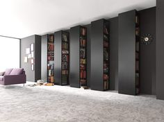 Wowsers! A full wall of sliding book cases put at 90 degree angle!