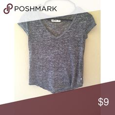 gray t-shirt light weight gray v-neck. in perfect condition. •will not model, no longer fits•offers are welcome•no trades•I do bundle• Hollister Tops Tees - Short Sleeve