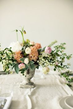 organically arranged wedding centerpiece in urn