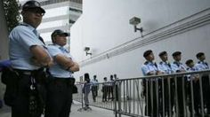 Police officers standing guard outside a building in China. File image