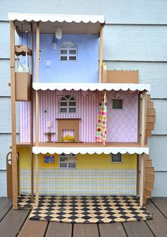 ikat bag: Cardboard Barbie House, with working elevator and lights! Cardboard Dollhouse, Cardboard Crafts, Diy Dollhouse, Homemade Dollhouse, Cardboard Playhouse, Cardboard Castle, Cardboard Kitchen, Cardboard Houses, Cardboard Design