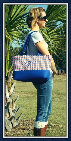 Large Orange and Blue canvas bottom diaper bag.  7 to 8 elastic pockets  Water proof lining  Silicone Aqua guarded on the outside Canvas straps