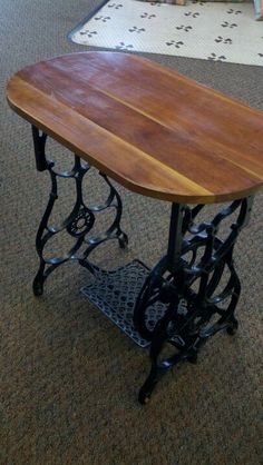 Old sewing machine made into a table! Come check it out at MorLyn's!