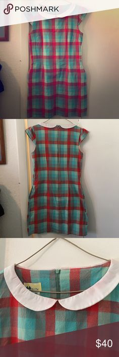 Peter Pan cap sleeved retro plaid flannel dress Adorable geeky fun plaid flannel dress with Peter Pan collar, cap sleeves, pockets!  Fully lined, zipper back closure, gently worn and washed, machine-dried. Needs an iron!  Maybe I'll get on that and redo photos... Made by Happy Yellow Bliss, bought at Modcloth. Colors are tomato red, Aqua and mint, with a white collar. ModCloth Dresses Mini