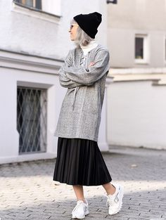 Get this look: http://lb.nu/look/7886780 More looks by Esra E.: http://lb.nu/esra Items in this look: Front Row Shop Grey Lace Up Dress, Zara Black Pleated Skirt, Zara White Sneakers #edgy #minimal #sporty #dressoverskirt #layering #fall #streetstyle #inspiration #look