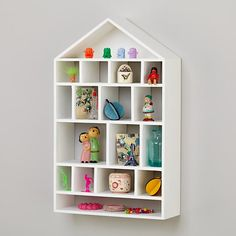Four Story Wooden Wall Shelf (White)  |  Land of Nod  |  $149  |  for all of the girls' tiny treasures...