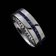 I like this as a men's wedding band. Princess Cut Channel Set Sapphire 18k White Gold Men's Wedding Band Ring