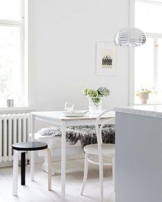 Fresh white and light grey kitchen in the Finnish home of Maija Rasila.