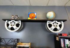 Vintage Furniture reuse car rims into repurposed furniture alloy wheels holders for wooden shelf decor idea - It is a great and unique idea to reuse car rims even if you like cars and all auto accessories. Car Part Furniture, Automotive Furniture, Automotive Decor, Furniture Plans, System Furniture, Woodworking Furniture, Woodworking Jointer, Bench Furniture, Modern Furniture