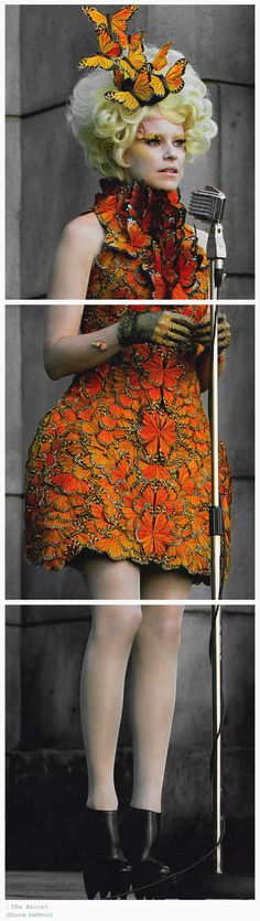 Elizabeth Banks as Effie Trinket In an Alexander McQueen dress made of 10,000 feathers hand painted to look like monarch butterflies, and Iris van Herpen ankle boots –for 'The Hunger Games: Catching Fire' #alexandermcqueendress