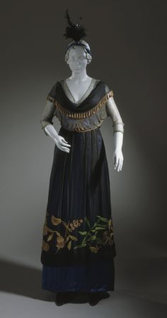 1914, America - Woman's Afternoon Dress - Satin underdress; overbodice of net woven with small steel beads, silk chifon, and copper metal trim; chiffon overskirt embroidered with large pattern with silk and metal threads