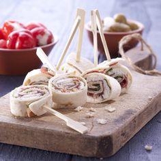 Wrap met rucola, geitenkaas, Jamón Serrano, pijnboompitjes en honing.