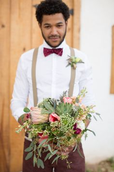 Love it when the groom holds the bouquet! And how amazing are the blooms?!