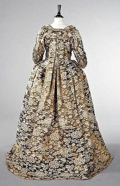 A robe à la Francaise of Chinese lampas satin, circa 1760, The fabric circa 1750, the satin woven with bronze and cream peonies and coiling foliage, the open-robe and petticoat trimmed with furbelows of matching braid trimmed silk, the sleeves with shirred double ruffled `sabot' cuffs, the back panel of the skirt of brown and white. 1740s European silk