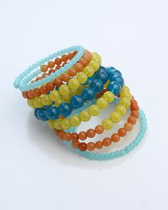 Vi Bella Jewelry - Colorblock Bracelet - You've seen it for yourself, color blocking is everywhere! The Colorblock Bracelet features band after band of beads in the season's hottest colors all strung on easy to wear memory wire.  Hues of light sea foam blue, bright coral, pale yellow and deep teal blue combine perfectly to create an accessory that really stands out!     Length Memory wire-one size fits all  Handcrafted by Vi Bella Artists in Haiti.  $29.95