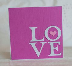 handmade valentine card ... clean and simple ... graphic look ... die cuts only ... LOVE letters in a 2X2 block placed in the lower right corner ... cute punche heart inside the O ... great card!!