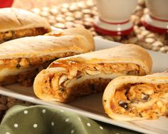 BBQ Chicken Stromboli 6 Rhodes Texas™ Rolls or 9 Rhodes™ Dinner Rolls, thawed to room temperature  2 cups cooked, shredded chicken  1 1/2 cups grated mozzarella cheese  1/3 cup chopped red onion  1/4 cup minced fresh cilantro  1 teaspoon smoked paprika  1/2 cup BBQ sauce