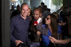 Greek Finance Minister Yanis Varoufakis is surrounded by the media as he leaves the Finance Ministry building in Athens, Greece, July 1, 2015. A defiant Prime Minister Alexis Tsipras urged Greeks on Wednesday to reject an international bailout deal, wrecking any prospect of repairing broken relations with EU partners before a referendum on Sunday that may decide Greece's future in Europe. REUTERS/Marko Djurica
