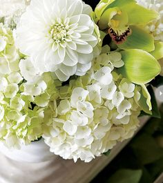Creamy white hydrangeas and mums mix with chartreuse orchids for a fresh colour scheme.