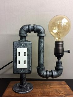 Items similar to Edison Lamp / Industrial Lamp / Steampunk / Pipe Lamp /Distressed Steel / Tesla Lamp / USB Charging Station / Desk Lamp / Home Decor on Etsy Industrial Desk, Vintage Industrial Furniture, Industrial Lighting, Industrial Farmhouse, Cool Lamps, Unique Lamps, Lampe Tube, Best Desk Lamp, Pipe Lighting