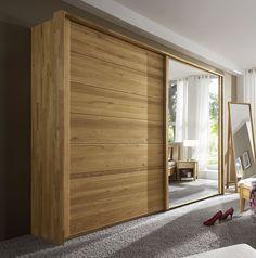 Robuster Massivholzschrank mit großer Spiegeltür. Ein echter Hingucker fürs Schalfzimmer. #massiv #holz #wohnen #kleiderschrank | betten.de http://www.betten.de/Kleiderschraenke/mit-schwebetueren/roseville-wildeiche-massiv-spiegel.html