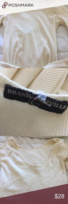 Never worn Brandy Melville long sleeve crop top Brandy Melville long sleeve crop top. Scoop is in back. Ribbed material. Cream/off white color. My daughter purged her drawers and this was never worn! Brandy Melville Tops Crop Tops