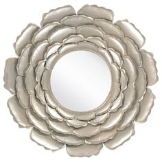 Showcasing a lovely floral-inspired frame, this statement-making wall mirror adds a glamorous touch above your fireplace or in the den.