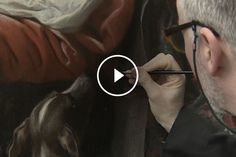 Video still of a conservator retouching a painting