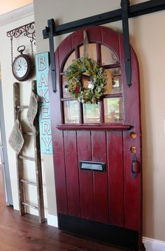 GORGEOUS arched door hung barn-style for pantry -- this is simply fantastic!!!