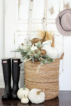 Transform a basic basket into a unique fall accent with the addition of white cloth pumpkins and greenery.