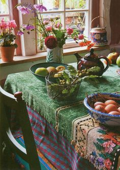 Layered table linens, mixed serving pieces.