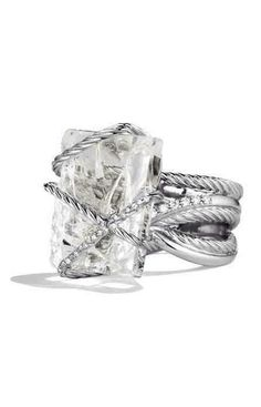 Wrapped in love. With a cushion cut not emerald cut. Love this !!!