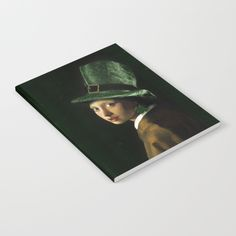 #StPatricksDay Girl With A Shamrock Earring  Notebook at #Society6 #Gravityx9 -  Our notebooks feature wraparound artwork from the world's best artists, with an anti-scuff laminate cover. Unleash your creativy on 52 pages of high quality 70lb text paper - minimal show-through even when you use heavy ink! Available in lined and unlined versions.
