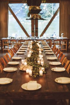 Rustic elegance wedding. Dark wooden tables, with greenery and lots of candles. love.
