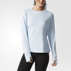 With a loose fit through the body and a slim fit on the sleeves, this women's pullover offers a secure but unrestricted feel as you run. The crewneck shirt features an adjustable drawcord waist and thumb holes to keep sleeves in place. A small zip pocket on the cuff has a waterproof coating.