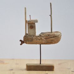driftwood fishing boat   £22.50 ...love the detail of an adorable thumb screw as the propeller.....vwr