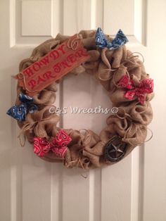 Country Western burlap wreath.  Accented with a horseshoe and bandana bows. Can be customized.