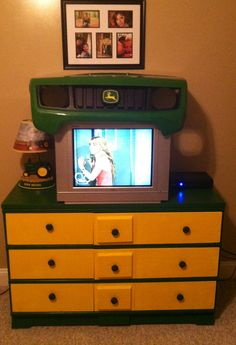 John Deere dresser and a John Deere gator hood to enclose the television