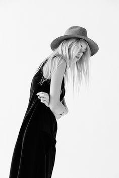 gray felt hat and black dress