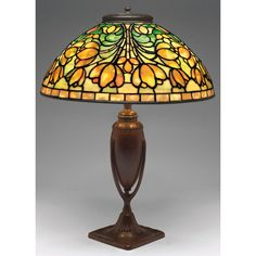 """Tiffany Studios New York """"Crocus"""" leaded glass and patinated bronze table lamp."""