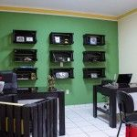 Office furnished with pallets and fruit boxes