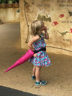 This shimmery costume tail was born to dazzle. A swoosh of this delightful dinosaur tail will make you the star of any show. Move over world, the Ballerina-saurus has arrived.