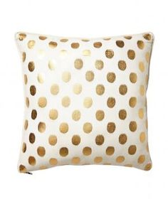 Luminous Dots Pillow: These polka dots are shimmery and whimsical. Place this pillow in a little girl's room for a delightful display or for a more sophisticated yet sassy touch, add it on a sleek, black leather couch.