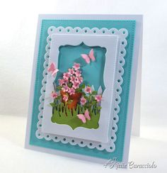 Come check out how I use a die cut flower pot as the main focal point of the scene.