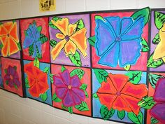 3rd Grade O'Keeffe Flowers - Cut out leaves separate from flower. Crayon on Construction paper background